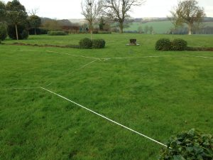 Measuring a garden for a marquee during site visit
